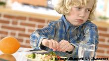 Kind am Essen