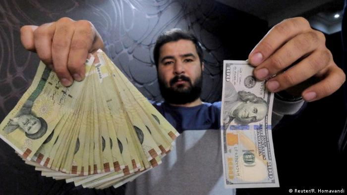 A man changing Iranian rials for dollars