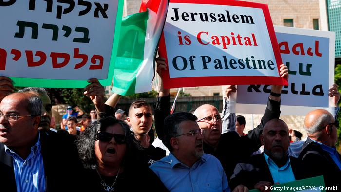 Palestinians demonstrate outside the new US embassy