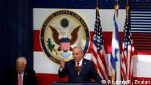 Israeli Prime Minister Benjamin Netanyahu speaks as U.S. Ambassador to Israel David Friedman sits next to him during the dedication ceremony of the new U.S. embassy in Jerusalem, May 14, 2018. REUTERS/Ronen Zvulun