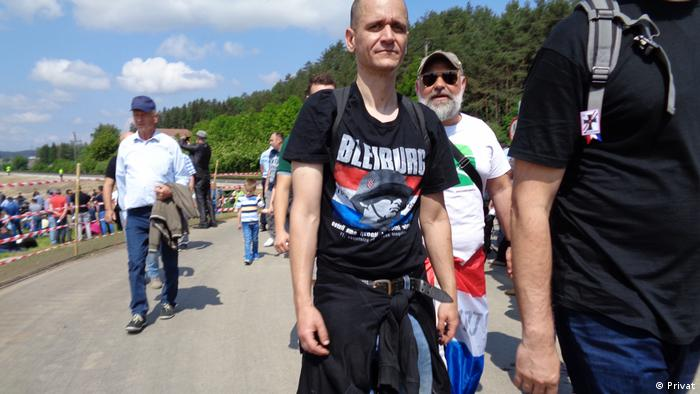 A man wears an image of a Croatian Ustasha soldier in Bleiburg