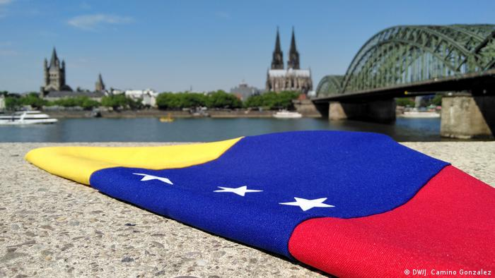 Venezuelan flag with Cologne Cathedral in background