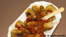 Sliced sausage with curry sauce on paper plate, Currywurst PUBLICATIONxINxGERxSUIxAUTxHUNxONLY WESTF00392 sliced Sausage With Curry Sauce ON Paper Plate Currywurst PUBLICATIONxINxGERxSUIxAUTxHUNxONLY WESTF00392.