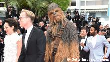 15.05.2018 CANNES, FRANCE - MAY 15: Actress Phoebe Waller-Bridge, actor Paul Bettany, Chewbacca, actors Donald Glover and Alden Ehrenreich attend the European Premiere of 'Solo: A Star Wars Story' at Palais des Festivals on May 15, 2018 in Cannes, France. (Photo by Antony Jones/Getty Images for Disney)