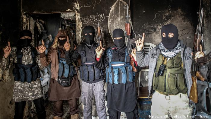 Members of al-Qaida with covered face from different nationalities, they are in an area called the Air Force Intelligence in Aleppo fighting with al-Assad's army elements in the front line