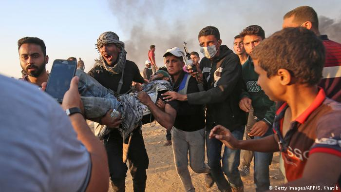 Injured protester being carried during (Getty Images/AFP/S. Khatib)