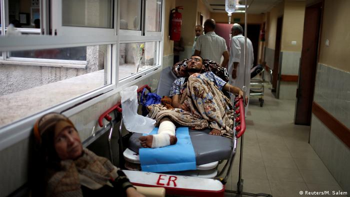 An injured Palestinian lies in hospital following protests in Gaza