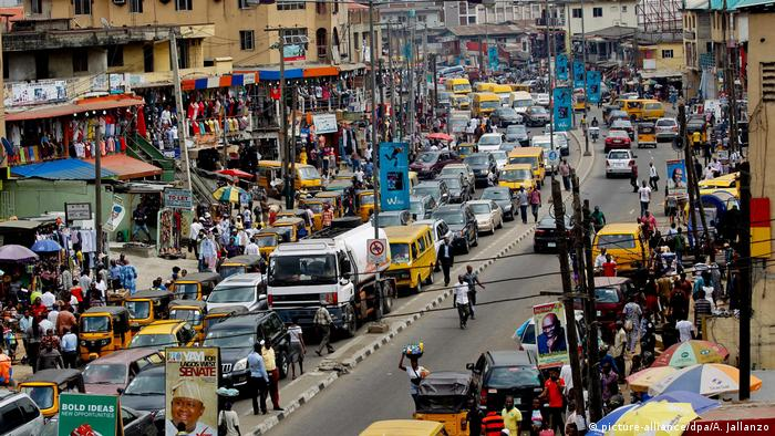 Traffic and people fill a street in Lagos