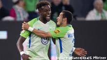 Divock Origi celebrates his opening goal with teammate William during the 3-1 first-leg win in Wolfsburg, Germany — 17.05.2018. (picture-alliance/dpa/S. Pförtner)