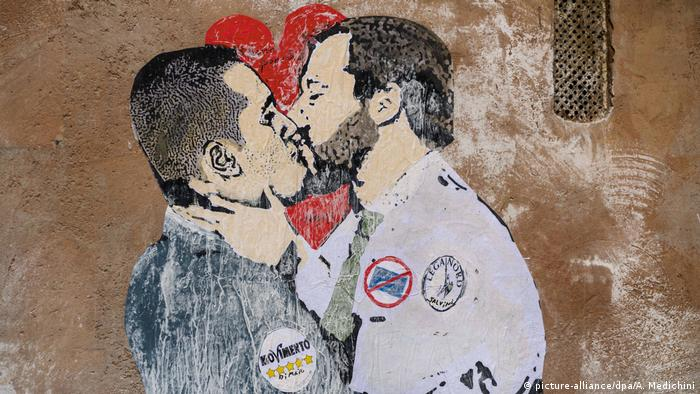 The M5S and League leaders kiss in an artistic interpretation graffitied on a Rome wall