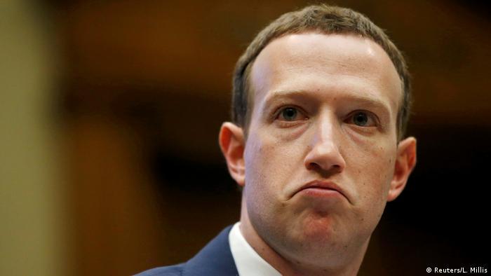 Marc Zuckerberg wears a frown