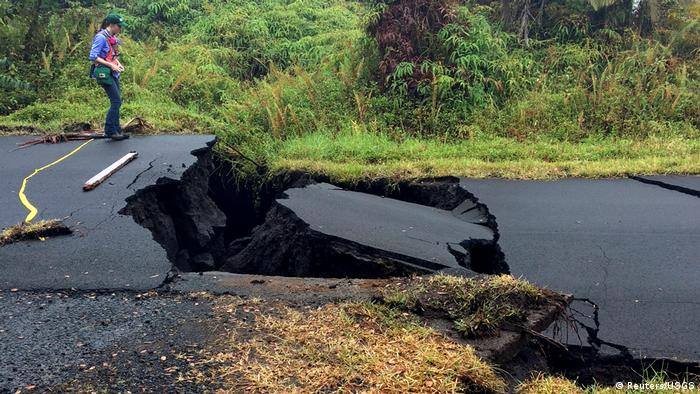A geologist inspects cracks on a road following a volcano eruption in Hawaii (Reuters/USGS)
