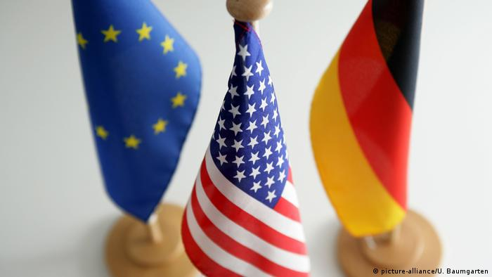 European Union, US, and German flags (picture-alliance/U. Baumgarten)