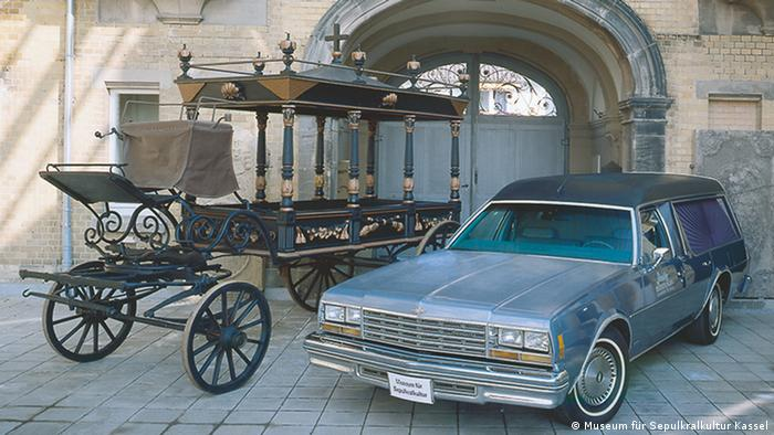 Old-fashioned funeral carriage and modern hearse (Museum für Sepulkralkultur Kassel)