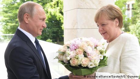 Коментар: Меркель та Путін між зближенням і недовірою