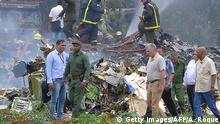 Cuban President Miguel Diaz-Canel (2-R, in khaki) is pictured at the site of the accident after a Cubana de Aviacion aircraft crashed after taking off from Havana's Jose Marti airport on May 18, 2018. - A Cuban state airways passenger plane with 104 passengers on board crashed on shortly after taking off from Havana's airport, state media reported. The Boeing 737 operated by Cubana de Aviacion crashed near the international airport, state agency Prensa Latina reported. Airport sources said the jetliner was heading from the capital to the eastern city of Holguin. (Photo by Adalberto ROQUE / AFP) (Photo credit should read ADALBERTO ROQUE/AFP/Getty Images)