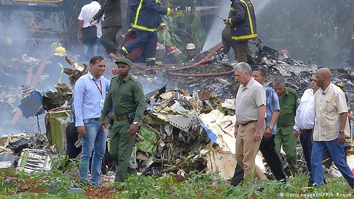 Cuban President Miguel Diaz-Canel (center, in gray shirt) is pictured at the site of the accident