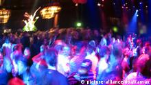 A blurred shot of a crowded dance floor at a party club in Berlin.