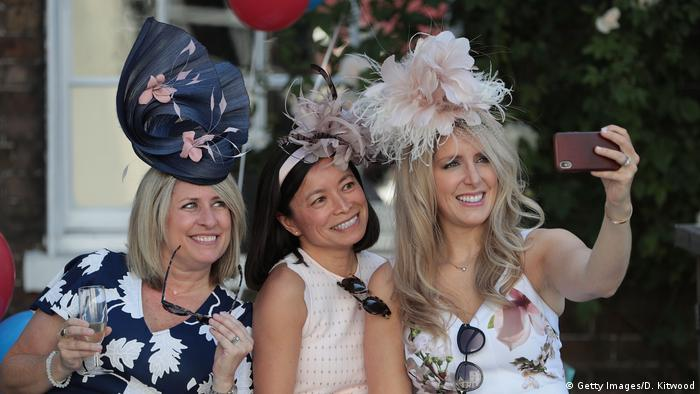 Three women taking a selfie in unusual hats (Getty Images/D. Kitwood)