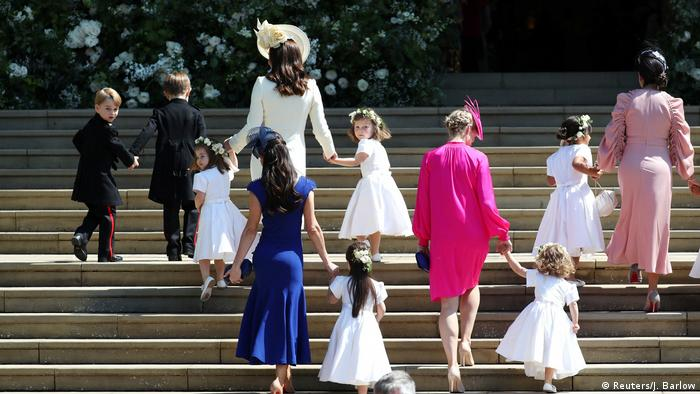 Page boys and flower girls being led up the steps at the royal wedding
