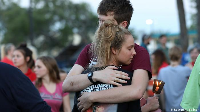 People grieve in Santa Fe texas (Reuters/T. Badger)