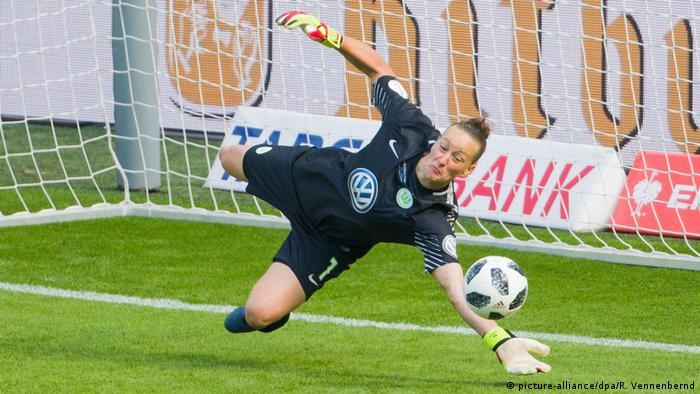 Almuth Schult makes a save for Wolfsburg