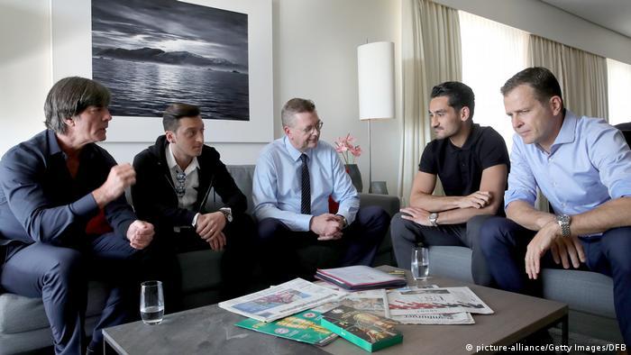 Özil and Gundogan meet with Germany manager Joachim Löw (left) and DFB President Reinhard Grindel (middle)