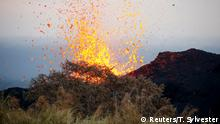 Lava erupts on the outskirts of Pahoa during ongoing eruptions of the Kilauea Volcano in Hawaii (Reuters/T. Sylvester)