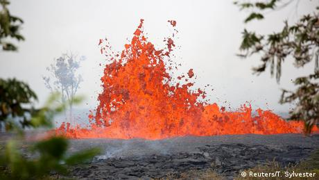 Lava erupts on near Pahoa during ongoing eruptions of the Kilauea Volcano in Hawaii (Reuters/T. Sylvester)