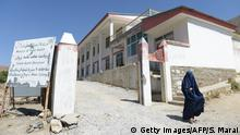 In this photograph taken on September 21, 2016 an Afghan woman walks from Salang hospital, north of Kabul. Fifteen years and tens of billions of dollars in foreign assistance later, Afghanistan is still dangerously unstable and persistently at the bottom of almost every major human development index, prompting donor fatigue at this week's crucial development aid conference in Brussels. / AFP / SHAH MARAI (Photo credit should read SHAH MARAI/AFP/Getty Images)