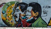 20.05.2018 - Caracas, Distrito Capital, Venezuela - A wall art featuring the president Maduro and the ex president Chavez..The presidential elections called by the National Constituent Assembly were carried out calmly in Venezuela. Few people participated and government points were seen, called red dots, on the outskirts of the polling centers that demanded the government's social assistance identification document known as Carnet de la Patria (the country card) where they should indicate that they had already voted for Maduro |