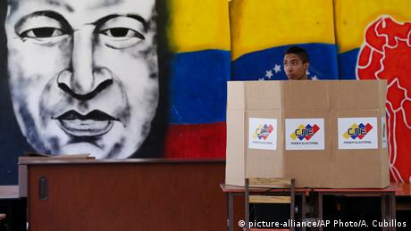A voter casts his ballot in Venezuela's controversial presidential election