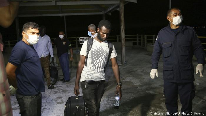 An unidentified African migrant arrives after he was rescued by fishermen
