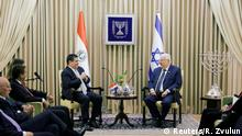 Paraguayan President Horacio Cartes sits next to Israeli President Reuven Rivlin at his residence in Jerusalem, ahead of the dedication ceremony of the embassy of Paraguay in Jerusalem, May 21, 2018. REUTERS/Ronen Zvulun