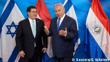 Israeli Prime Minister Benjamin Netanyahu gestures as he stands next to Paraguayan President Horacio Cartes during a meeting at the Prime Minister's office in Jerusalem, following the dedication ceremony of the embassy of Paraguay in Jerusalem, May 21, 2018. Sebastian Scheiner/Pool via Reuters *** Local Caption ***