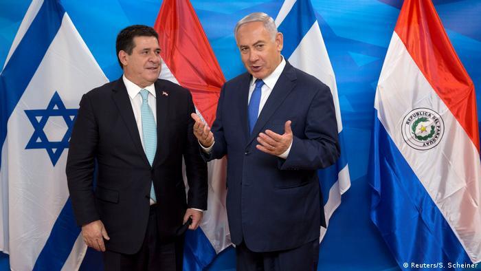 Israeli Prime Minister Benjamin Netanyahu gestures as he stands next to Paraguayan President Horacio Cartes