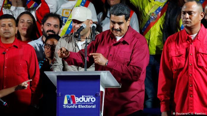Nicolas Maduro speaks on a podium