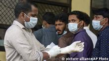 Indians standing in a queue outside a hospital wear masks as a precautionary measure against the Nipah virus in Kozhikode, in the southern Indian state of Kerala, Monday, May 21, 2018. The deadly virus has killed at least three people in southern India, officials said Monday, with medical teams dispatched to the area amid reports that up to six other people could have died from the disease and others are ill. (AP Photo) |