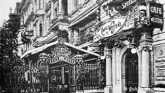 Historic black and white photo of Café des Westens on a street with many buildings in art nouveau style