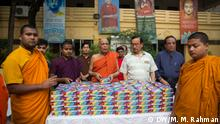 Monks at Dharmarajik Buddhist Vihara in Dhaka's Sabujbagh have been distributing Iftar among the poor every day for seven years during Ramadan, the Arabic month of fasting for Muslims.