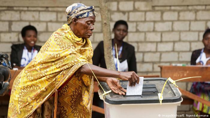 An elderly woman votes in Burundi