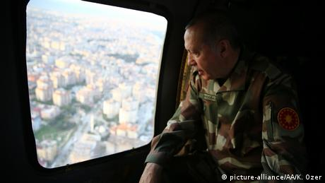 Erdogan in military uniform in a helicopter