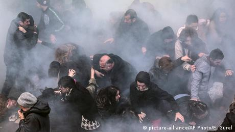 Protesters scattering after Turkish police use water cannons and tear gas to disperse crowds