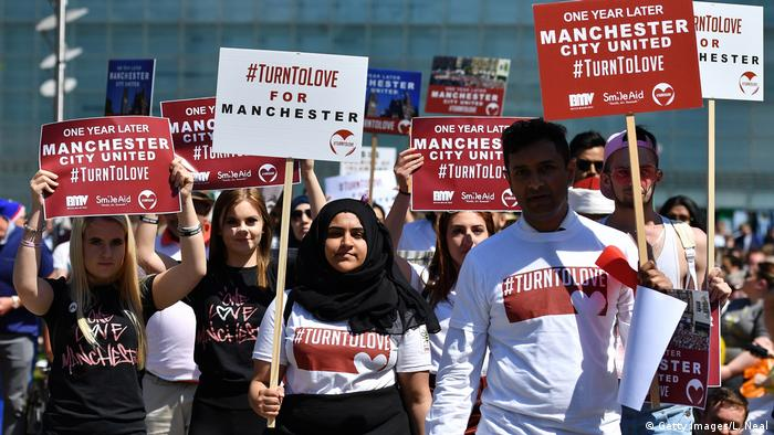#TurnToLove march in Manchester, England, one year after a terrorist attack killed 22 people at an Ariana Grande concert in May 2017 (Getty Images/L. Neal)