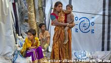 16.01.2018 FILE - In this Jan. 16, 2018, file photo, a Hindu refugee stands outside her makeshift shelter with her children, near Kutupalong refugee camp near Cox's Bazaar, Bangladesh. Amnesty International said Wednesday, May 23, 2018, that Myanmar's army was not the only force that has slaughtered civilians in the country's volatile west. In a new report, the rights group accused ethnic Rohingya insurgents of carrying out at least one brutal massacre of minority Hindus when the long-running conflict in Rakhine state exploded last year. (AP Photo/Manish Swarup, File) |