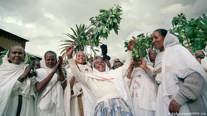 Eritrean women wave branches in celebration (Getty Images/AFP/A. Joe)