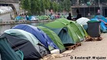 Tents where migrants live are seen in a makeshift camp along the Quai de Valmy (background) and Quai de Jemmapes of the canal Saint-Martin in Paris, France, May 15, 2018. Picture taken May 15, 2018. REUTERS/Philippe Wojazer