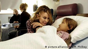 Kylie visits two sick children in hospital