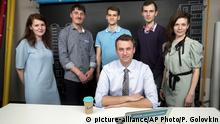 In this photo taken on Thursday, May 18, 2017, Russian opposition leader Alexei Navalny, center, and his team, stand from left: Navalny's spokeswoman Kira Yarmysh, live broadcast director Alexei Yakovlev, live broadcast director Artem Guryev, employee of Navalny's Foundation for Fighting Corruption Ilya Pakhomov, and chief of Navally's video operations Oksana Baulina, pose for a picture at the office of the Foundation for Fighting Corruption in Moscow, Russia.Blacklisted by state-owned media, Navalny is tapping into the resources of YouTube. The broadcasts have become a key piece of Navalny?s strategy to galvanize opposition to President Vladimir Putin and the upper echelons of power that he says are awash in corruption. The videos regularly attract more than a million views and contribute to the opposition?s resurgence after years of being marginalized and riddled by internal disputes. (AP Photo/Pavel Golovkin) |