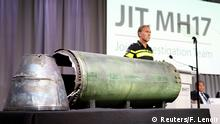 A damaged missile is displayed during a news conference by members of the Joint Investigation Team, comprising the authorities from Australia, Belgium, Malaysia, the Netherlands and Ukraine who present interim results in the ongoing investigation of the 2014 MH17 crash that killed 298 people over eastern Ukraine, in Bunnik, Netherlands, May 24, 2018. REUTERS/Francois Lenoir